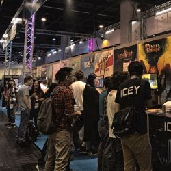 Gamers enjoying what the developers at the Indie Arena Booth at Gamescom trade fair had to offer
